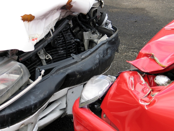 Woman dies in head on collision